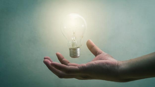 Light bulb in man's palm