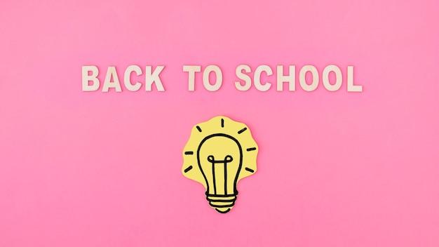 Light bulb near back to school writing