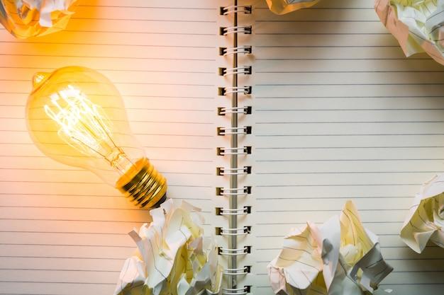 Light bulb on a notebook close-up