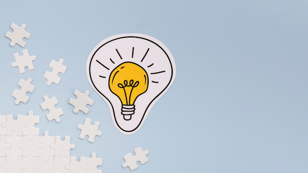 Light bulb and puzzle pieces with copy space