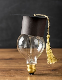 Light bulb with graduation cap