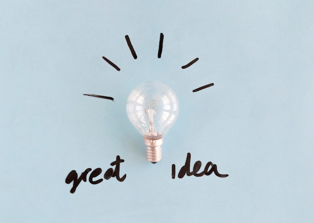 Light bulb with great idea word on blue background