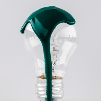 Light bulb with green paint