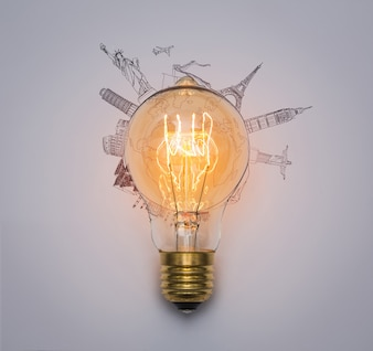 Light bulb with monuments drawn around