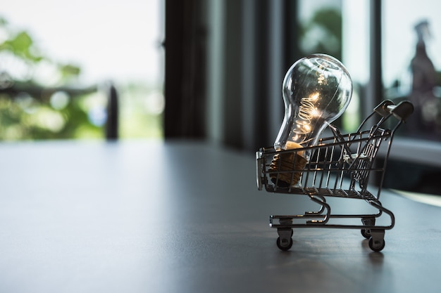 Light bulb with shopping cart