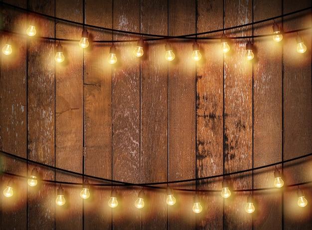 Light bulb on wooden background.