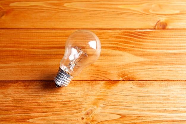 Light bulb on a wooden table