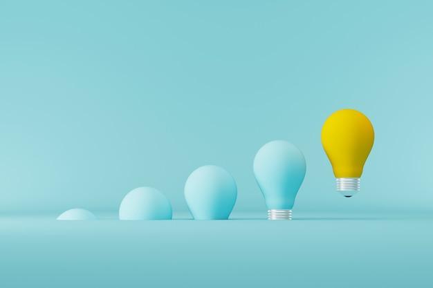 Лампочка желтая, плавающая выдающаяся среди лампочек светло-синего цвета на фоне