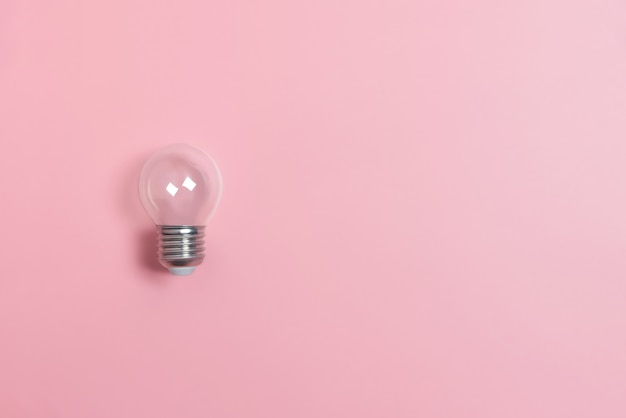 Light bulbs on pink wall with copy space.
