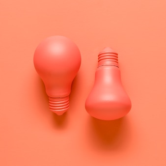 Light bulbs on red background