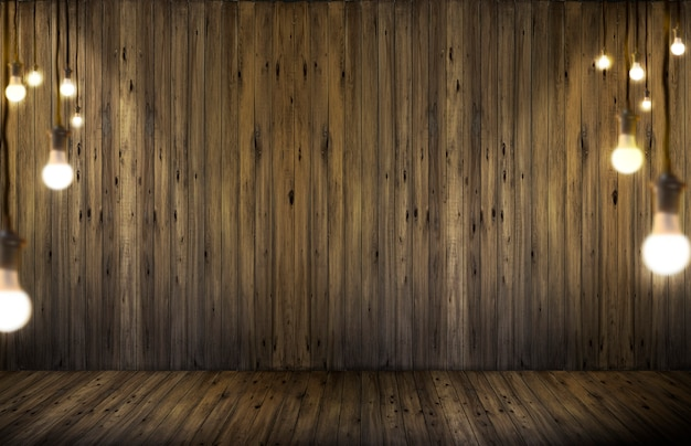 Light bulbs on wood background.