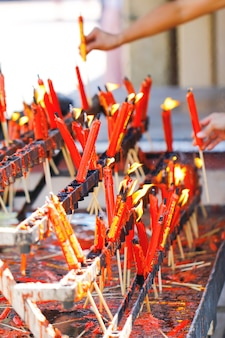 The light of candle and incense on the table food for spirits in chinese ghost festival
