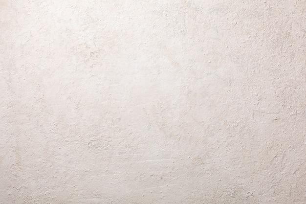 軽いコンクリートまたは石膏のテクスチャ、ラフな抽象的な背景
