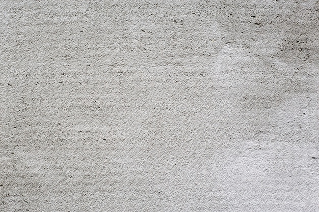 Light and dark grey divided in parts concrete damaged background texture