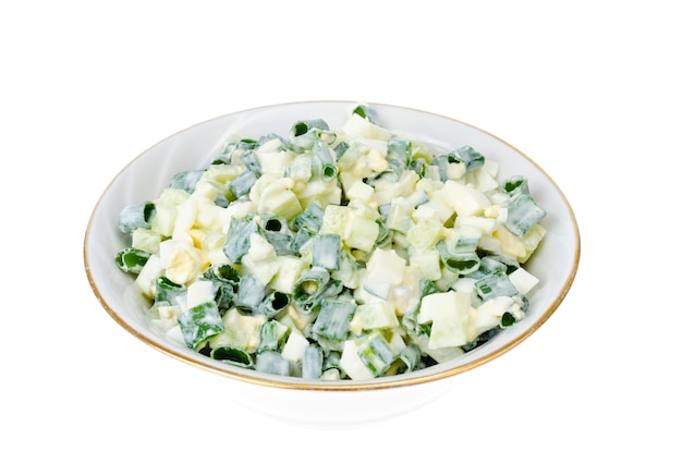 Light diet salad with boiled egg, green onions and fresh cucumber
