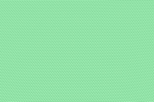 Light emerald green background from a textile material.