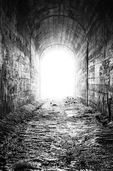 Light at the end of the tunnel black and white photo