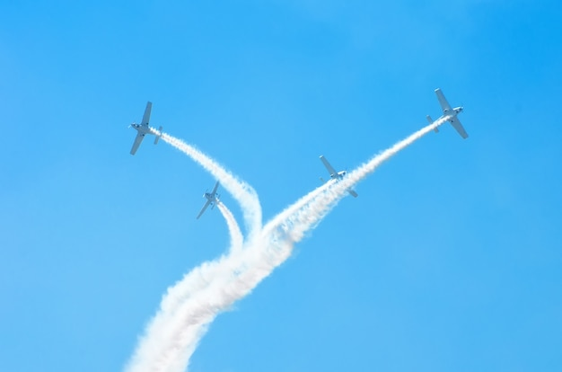Light engine airplanes with a trace of white smoke