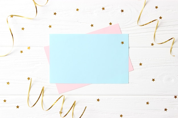 Light festive background with sparkles and ribbons with place for text