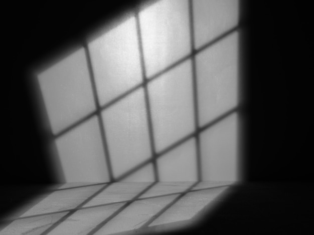 Light from a window on a black wall. overlay background