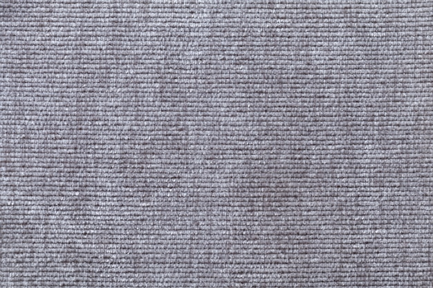 Light gray background from soft textile material. fabric with natural texture.