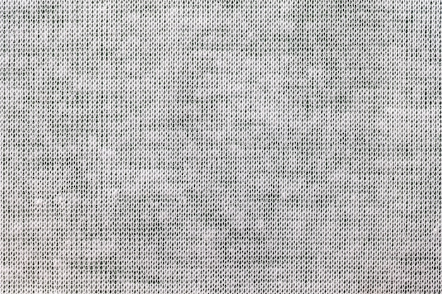 Light gray, background from a textile material. fabric with natural texture. backdrop.