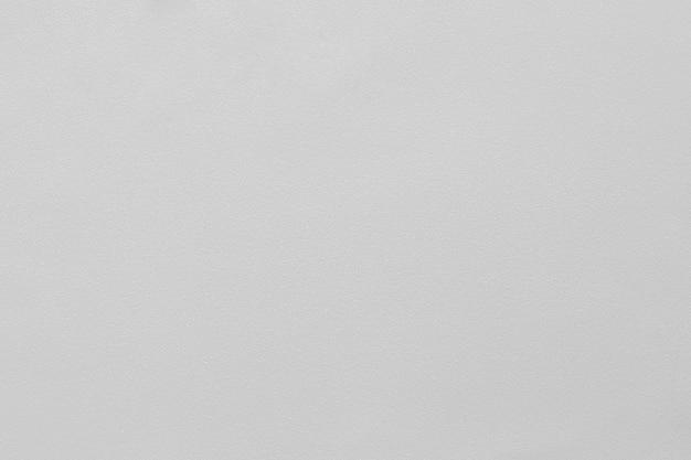 小さな輝きと質感のある明るい灰色の背景。 (マイクロテクスチャに焦点を当てたマクロ)
