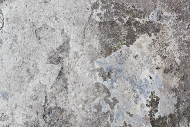 Светло-серый фон потрескавшейся каменной стены, бетон