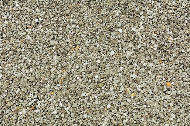 Light gray gravel (pebble) floor texture background - top view.