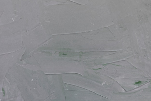 Light gray and green rough concrete wall or stucco texture wall