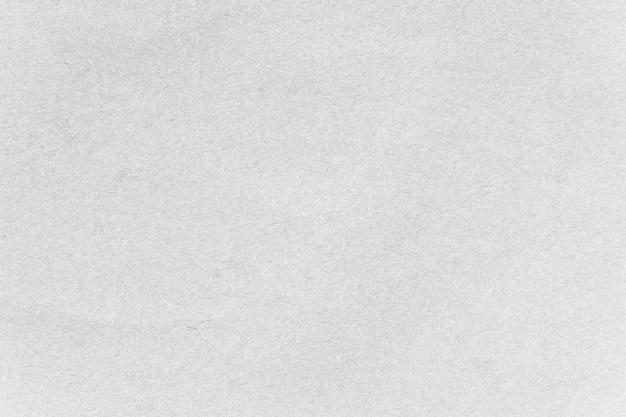 ライトグレーのクラフト紙のテクスチャ背景