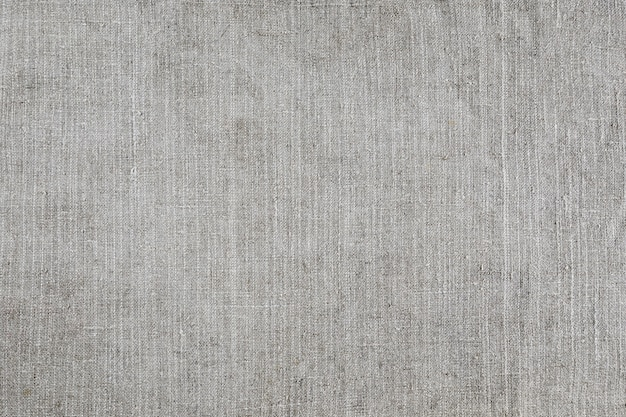 Light gray natural linen texture for the background. close up of old cloth