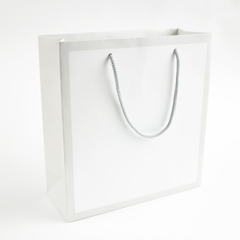 Light gray paper bag mockup for design on a gray background. space for text. sale concept