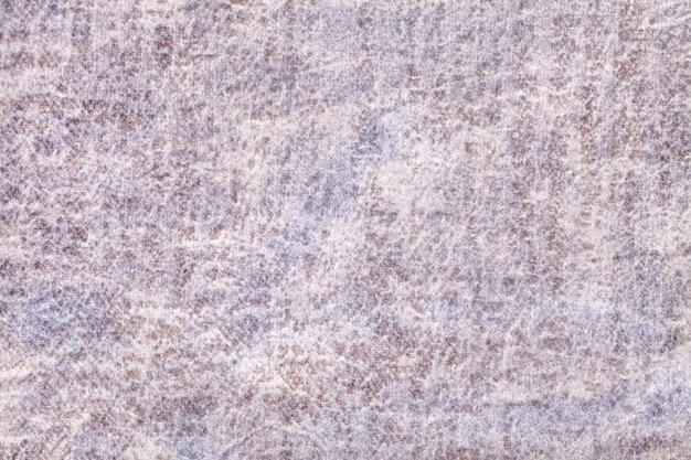 Light gray and pearl fluffy background of soft, fleecy fabric. texture of ivory velveteen textile Premium Photo
