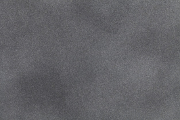 Light gray suede fabric closeup. velvet texture.