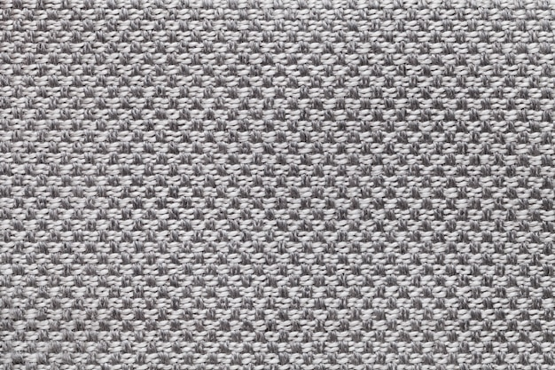 Light gray textile with checkered pattern, closeup. structure of the fabric macro.