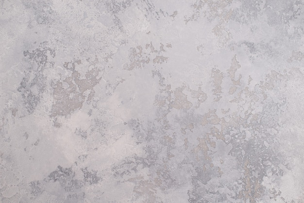 Light gray texture of decorative venetian plaster for the background.