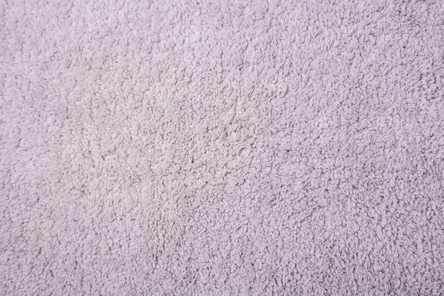 Light gray texture of hairy bath mat. view from above
