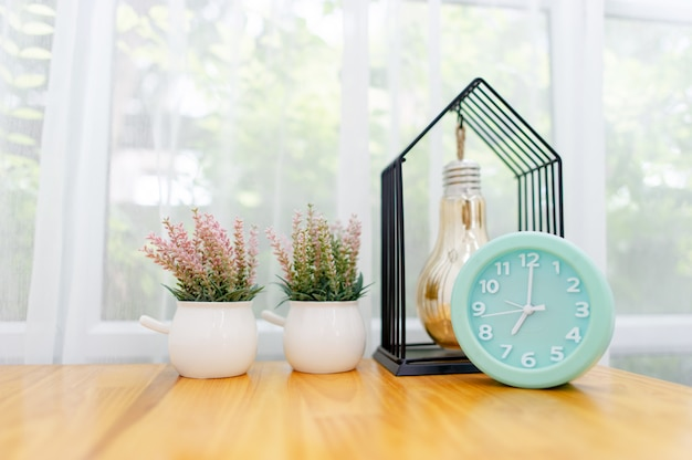 Light green alarm clock placed on the table in the bedroom