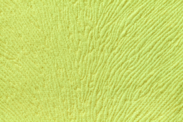 Light green background from soft textile material. fabric with natural texture.