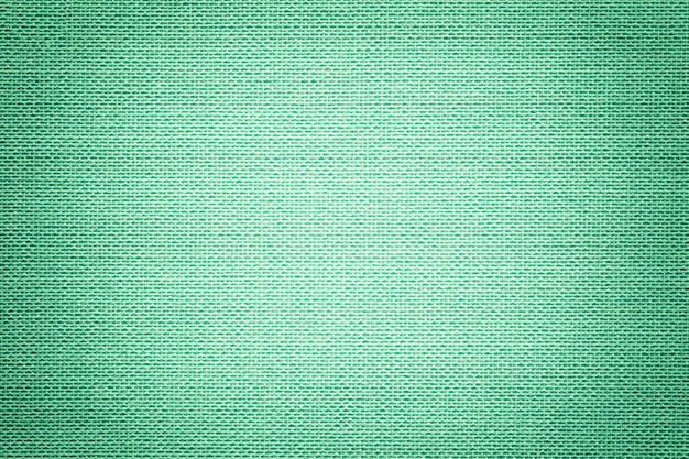 Light green background from a textile material with wicker pattern