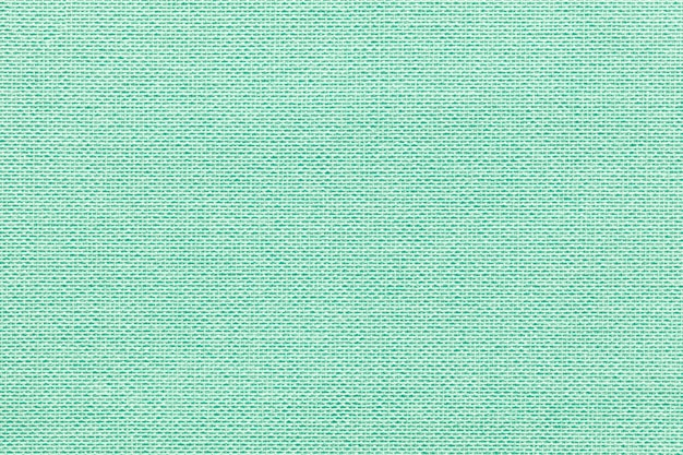 Light green background from a textile material with wicker pattern,