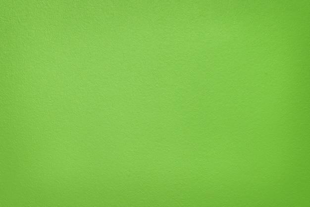 背景とデザインアートワークのための薄緑色のコンクリートセメント壁のテクスチャ。