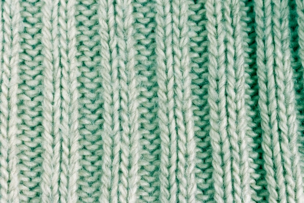 Light green cotton knitted fabric texture background. toned image