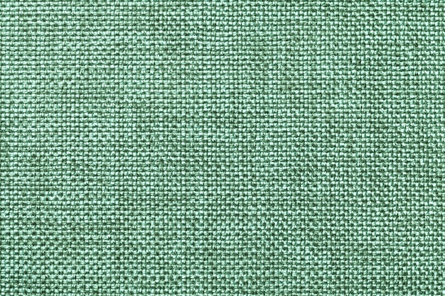 Light green textile background closeup. structure of the fabric macro
