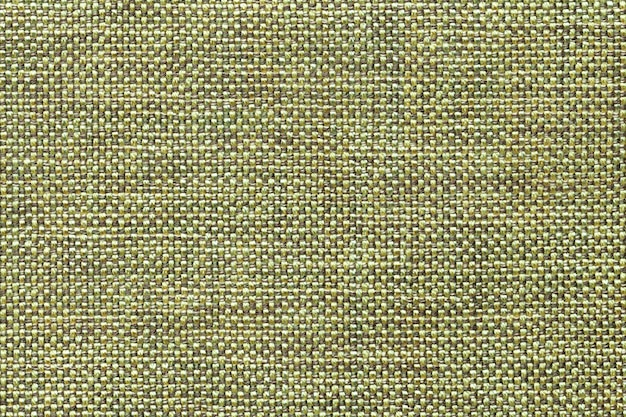 Light green textile background with checkered pattern, closeup. structure of the fabric macro.