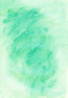 Светло-зеленый акварельный фон, нарисованный на фактурной бумаге. пастельный изумрудный фон.