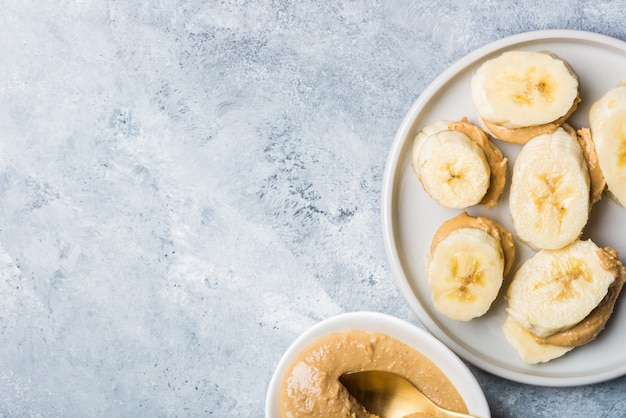 Light healthy snack made from banana slices and cashew butter