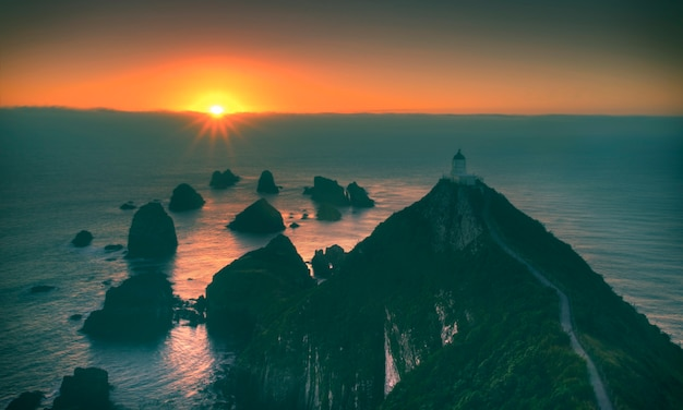 Light house nugget points new zealand scenery concept