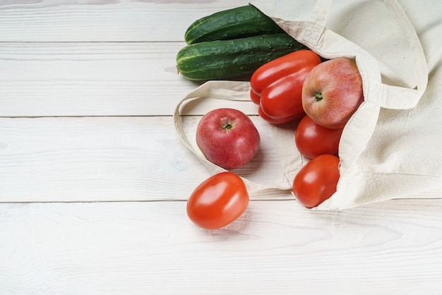Light linen eco bag with fresh vegetables and fruits